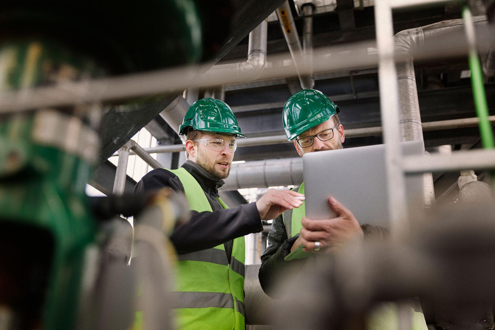 workers-reviewing-laptop.jpg